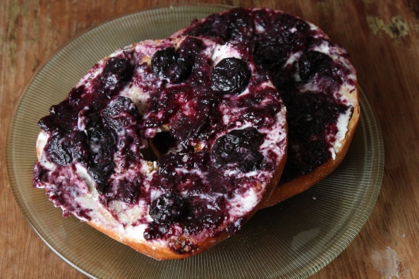 A delicious treat: a raisin bagel with goat cheese and jam