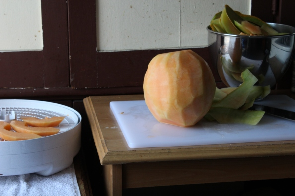 Removing the rind from the cantaloupe