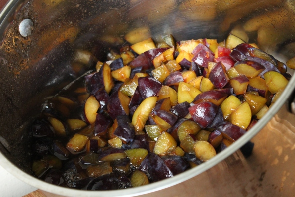 Plums macerating in sugar