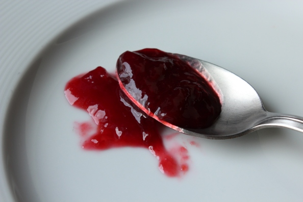 Plum jam on spoon and plate