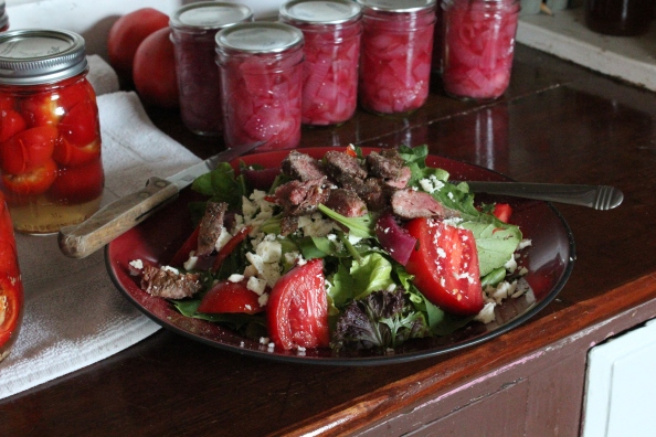 Steak salad featuring pickled hot peppers and onions