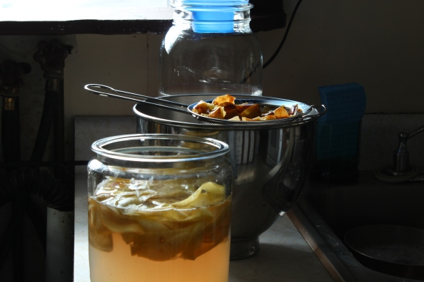 Straining the apple peel ferment for a second fermentation