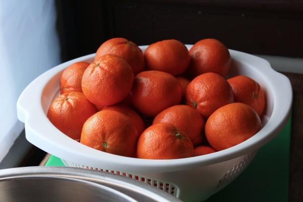 Strainer full of mandarin oranges