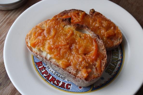 Mandarin orange marmalade on fresh bread