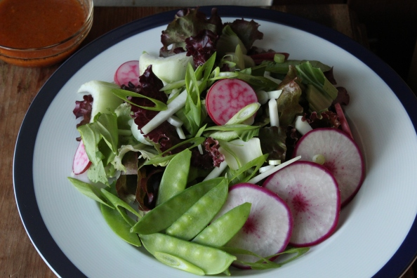 Early summer salad with lettuces, radishes, turnips, snow peas, and scallions