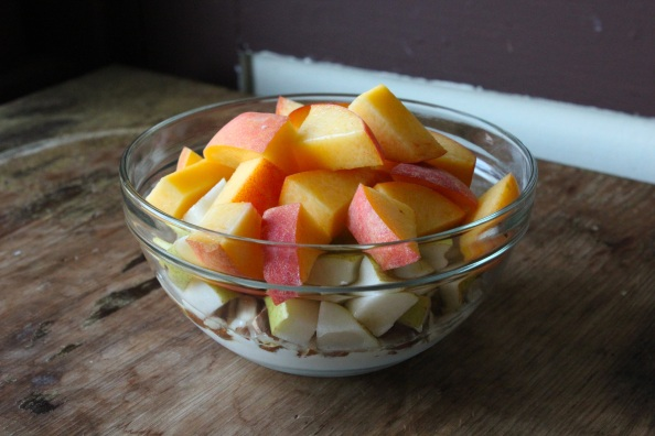 Local peach and pear fruit salad with almonds, yogurt, and honey