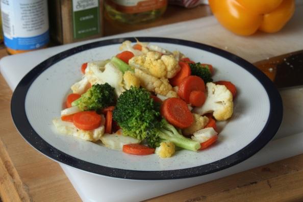 Sauteed broccoli, cauliflower, and carrots with garlic