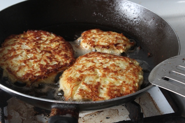 Black radish and potato pancakes browning in the pan